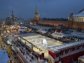 Red Square decorated for New Year celebrations is seen from a roof of the Moscow GUM State Department store in Moscow, Russia, Saturday, Dec. 22, 2018. (AP Photo/Alexander Zemlianichenko, Pool)