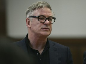 Actor Alec Baldwin stands in a New York City court, Wednesday, Jan. 23, 2019, for a hearing on charges that he slugged a man during a dispute over a parking spot last fall. (Alec Tabac/The Daily News via AP, Pool)