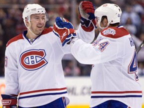 Montreal Canadiens defenceman Josh Gorges, left, celebrates his goal with teammate Roman Hamrlik, of Czech Republic, during third period NHL action against the Toronto Maple Leafs in Toronto on April 4, 2009.