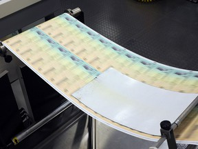 Blank U.S. Treasury checks are run through a printer at the printing facility July 18, 2011 in Philadelphia. (William Thomas Cain/Getty Images)