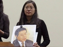 Ti-Anna Wang, holds a photo of her father Wang Bingzhang in a file photo.
