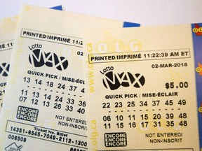 A lotto Max ticket is shown in Toronto on Monday Feb. 26, 2018.