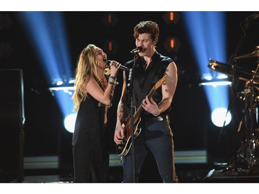 LOS ANGELES, CA - FEBRUARY 10:  Miley Cyrus (L) and Shawn Mendes perform onstage during the 61st Annual GRAMMY Awards at Staples Center on February 10, 2019 in Los Angeles, California.