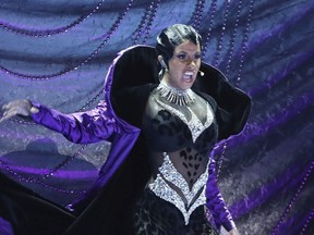 """In this Sunday, Feb. 10, 2019, file photo, Cardi B performs """"Money"""" at the 61st annual Grammy Awards in Los Angeles."""