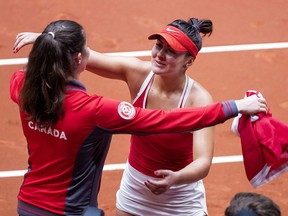 Canada's Bianca Andreescu celebrates with a teammate after winning her Fed Cup World Group II match against Netherlands' Arantxa Rus on February 10, 2019. (Koen Suyk / ANP / AFP)