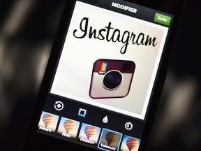 The Instagram logo is displayed on a smartphone on Dec.20, 2012 in Paris.