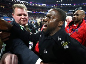 Actor and comedian Kevin Hart celebrates the New England Patriots 13-3 win over the Los Angeles Rams during Super Bowl LIII at Mercedes-Benz Stadium in Atlanta on Sunday, Feb. 3, 2019.