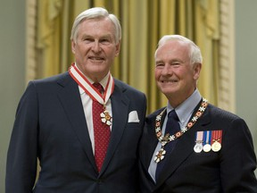Governor General David Johnston stands with Michael Wilson after investing him as a Companion of the Order of Canada during a ceremony at Rideau Hall in Ottawa on November 17, 2010. Michael Wilson, a former politician, diplomat and longtime mental health advocate, has died at 81. The University of Toronto, where Wilson served as chancellor from 2012 to 2018, confirmed his death in a post on its website Sunday evening.