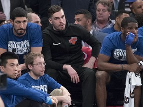 New York Knicks centre Enes Kanter. left, forward Mario Hezonja, centre, and guard Damyean Dotson, right, watch the game action from the bench during the first half of an NBA game against the Detroit Pistons, Tuesday, Feb. 5, 2019, at Madison Square Garden in New York.