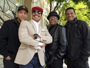 In this Tuesday, Feb. 26, 2019, Marlon Jackson, second from left, Tito Jackson, second from right, and Jackie Jackson, far right, brothers of the late musical artist Michael Jackson, and Tito's son Taj, far left, pose together for a portrait outside the Four Seasons Hotel, in Los Angeles.