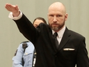 Anders Behring Breivik raises his right hand at the start of his appeal case in Borgarting Court of Appeal at Telemark prison in Skien, Norway, Tuesday, Jan. 10, 2017.