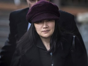 In this Jan. 29, 2019, file photo, Huawei chief financial officer Meng Wanzhou leaves her home to attend a court appearance in Vancouver, British Columbia.