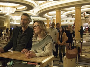 """This image released by A24 shows John Torturro and Julianne Moore in a scene from """"Gloria Bell."""""""