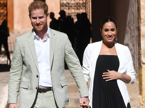 Prince Harry, Duke of Sussex, and Meghan, Duchess of Sussex, walk through the walled public Andalusian Gardens which has exotic plants, flowers and fruit trees during a visit on Feb. 25, 2019 in Rabat, Morocco.  (Facundo Arrizabalaga - Pool/Getty Images)
