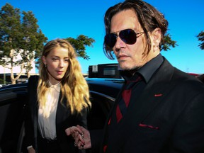 Johnny Depp, right, and Amber Heard arrive at a court in the Gold Coast on April 18, 2016.