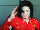 In this file photo taken on March 19, 1996, Michael Jackson waves to photographers during a press conference in Paris. (VINCENT AMALVY/AFP/Getty Images)