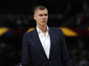In this March 14, 2019, file photo, Dallas Mavericks forward Kristaps Porzingis stands during the second half of the team's NBA basketball game against the Denver Nuggets in Denver.