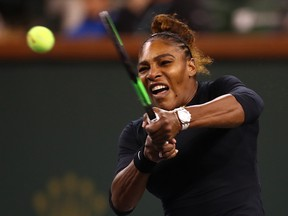 Serena Williams of the United States plays a backhand against Victoria Azarenka of Belarus during their women's singles second round match on day five of the BNP Paribas Open at the Indian Wells Tennis Garden on March 8, 2019 in Indian Wells, Calif.