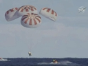 This image provided by NASA shows SpaceX's Dragon capsule carrying a test dummy splashed down into the Atlantic Ocean off the Florida coast, Friday, March 8, 2019.