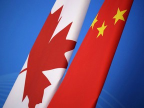 Flags of Canada and China are placed for the first China-Canada economic and financial strategy dialogue in Beijing, China, Monday, Nov. 12, 2018.