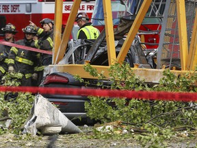 A construction crane working on a building collapsed near the intersection of Mercer Street and Fairview Avenue near Interstate 5, Saturday, April 27, 2019, in downtown Seattle. (Genna Martin/seattlepi.com via AP)