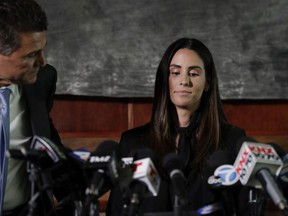 Attorney Garo Mardirossian, left, pats the back of former sports reporter Kelli Tennant before the start of a news conference, Tuesday, April 23, 2019, in Los Angeles.