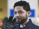 Actor Jussie Smollett smiles and waves to supporters before leaving Cook County Court after his charges were dropped in Chicago, on March 26, 2019.