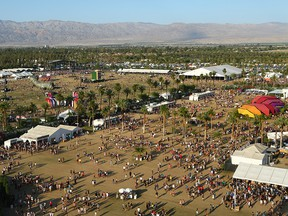 In this April 19, 2015, file photo, festival-goers attend the Coachella Music and Arts Festival in Indio, Calif.