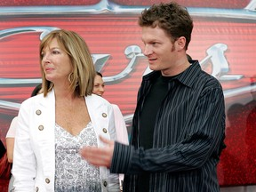 "In this May 26, 2006, file photo, NASCAR driver Dale Earnhardt Jr., right, and his mother Brenda Jackson, front left, arrive for the premiere of the Disney/Pixar animated film ""Cars"" at Lowe's Motor Speedway in Concord, N.C."