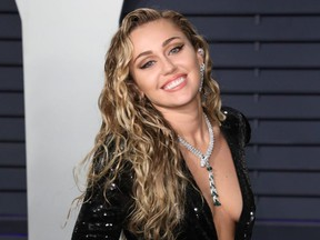 Miley Cyrus attends the 2019 Vanity Fair Oscar Party following the 91st Academy Awards at The Wallis Annenberg Center for the Performing Arts in Beverly Hills, Calif., Feb. 24, 2019.