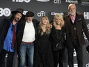 Inductee Stevie Nicks, center, poses with other members of Fleetwood Mac, from left, Mike Campbell, John McVie, Christine McVie and Mick Fleetwood at the Rock & Roll Hall of Fame induction ceremony in New York on March 29, 2019. Fleetwood Mac is postpoing four Canadian tour dates as Stevie Nicks deals with the flu. A statement issued by the band says concerts in Toronto (April 8), Winnipeg (April 11), Edmonton (April 13) and Calgary (May 2) will all be rescheduled, in addition to a number of U.S. dates.