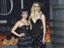 Maisie Williams, left, and Sophie Turner attend HBO's