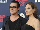 In this May 12, 2014 file photo, Brad Pitt and Angelina Jolie attend the premiere of HBO Films'