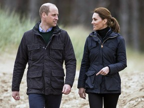 Prince William and Kate, Duchess of Cambridge smile during a visit to Newborough Beach in North Wales, Wednesday, May 8, 2019. (Aaron Chown/PA via AP)