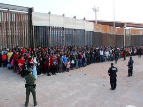 This May 29, 2019 photo released by U.S. Customs and Border Protection (CBP) shows some of 1,036 migrants who crossed the U.S.-Mexico border in El Paso, Texas. (U.S. Customs and Border Protection via AP)