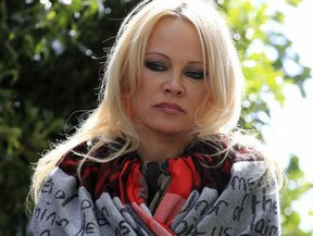 US actress Pamela Anderson speaks to the media outside Belmarsh Prison in south-east London, after visiting WikiLeaks founder Julian Assange, Tuesday May 7, 2019.