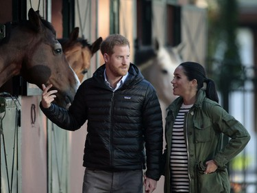 In this Monday, Feb. 25, 2019 file photo, Prince Harry and Meghan, Duchess of Sussex, walk together during a visit to the Moroccan Royal Equestrian Sports Complex in Rabat, Morocco.