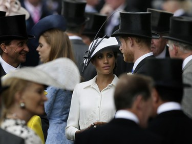 In this Tuesday, June 19, 2018 file photo, Prince Harry and Meghan, Duchess of Sussex, arrive on the first day of the Royal Ascot horse race meeting in Ascot, England.