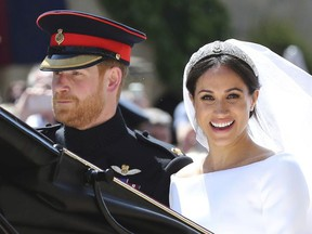 In this Saturday, May 19, 2018 file photo, Britain's Prince Harry and his wife Meghan Markle leave after their wedding ceremony, at St. George's Chapel in Windsor Castle in Windsor, near London, England. Sunday, May 19, 2019 marks the first wedding anniversary of the besotted couple.