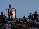 In this Thursday, May, 16, 2019 file photo, a supporter shows a Canadian flag during the match between Serbia's Novak Djokovic and Canada's Denis Shapovalov at the Italian Open, in Rome. (AP Photo/Alessandra Tarantino, File )