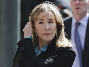 In this April 3, 2019 file photo, actress Felicity Huffman arrives at federal court in Boston to face charges in a nationwide college admissions bribery scandal.