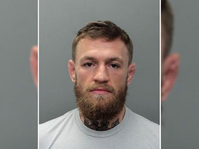 This photo provided by the Miami-Dade Corrections and Rehabilitation Department shows Conor McGregor. Authorities say mixed martial artist and boxer Conor McGregor has been arrested in South Florida for stealing the cellphone of someone who was trying to take his photo. A Miami Beach police report says the 30-year-old McGregor was arrested Monday, March 11, 2019 and charged with robbery and criminal mischief.