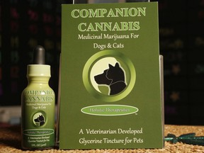 In this photo taken Thursday, May 30, 2013, Companion Cannabis, by Holistic Therapeutics, a Marijuana medicinal tincture for dogs and cats is seen at La Brea Compassionate Caregivers, a medical marijuana dispensary in Los Angeles Thursday, May 30, 2013.