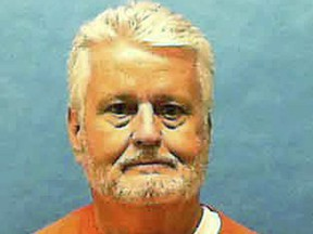 In this updated photo made available by the Florida Department of Law Enforcement shows Bobby Joe Long in custody.
