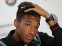 Canada's Felix Auger-Aliassime answers question during a press conference after withdrawing from the French Open, at the Roland Garros stadium in Paris, Sunday, May 26, 2019. (AP Photo/Pavel Golovkin)