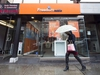 A women walks past the new rebranding sign of Freedom Mobile in Toronto on Thursday, November 24, 2016. Freedom Mobile says about 15,000 customers were affected by a security breach in a new system before the problem was fixed on April 23. THE CANADIAN PRESS/Nathan Denette