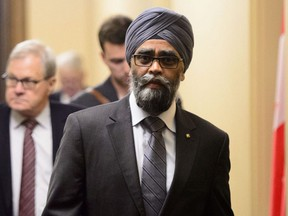 Minister of National Defence Minister Harjit Sajjan leaves a cabinet meeting on Parliament Hill in Ottawa on Tuesday, May 14, 2019.