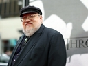 In this March 18, 2013 file photo, author George R.R. Martin arrives at the premiere for the third season of the HBO television series