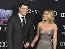 In this April 22, 2019, file photo, Colin Jost, left, and Scarlett Johansson arrive at the premiere of