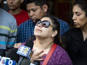 Surrounded by family members and supporters, Marlen Ochoa-Lopez's mother, Raquel Uriostegui, talks to reporters outside the Cook County medical examiner's office after identifying her daughter's body, Thursday, May 16, 2019 in Chicago.
